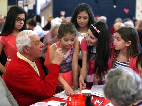 Ralph Nappi of Roxbury talks with 5th graders as students at Lincoln Roosevelt Elementary School host their annual Valentine's Day Luncheon for Roxbury senior citizens. February 16, 2017, Roxbury, NJ.