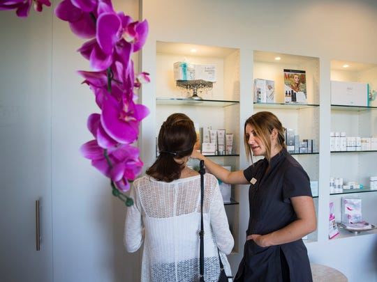"Krystle Anderson, a medical and laser esthetician, discusses products with a guest during the ""Brotox, Wings and Manhattans"" event at the Naples Laser and Med Spa in Bonita Springs, Florida on Thursday, Feb. 16, 2017. Ten percent of all profits from the event were donated to ZERO, a non-profit agency bringing awareness and help to men suffering from prostate cancer."