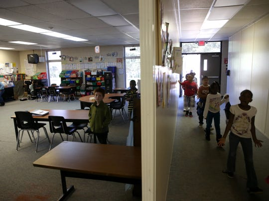 Children return to the classroom from their recess at the Jefferson County Elementary School on Thursday, Feb. 9, 2017.