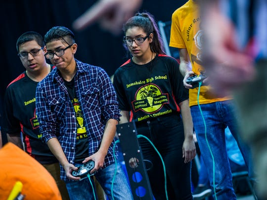 Immokalee High School Robotics Team members, from left, Isaiah Reyna, Kristian Trevino, and Jenni Villa compete in the VEX Robotics state championship at the Tampa Fairgrounds on Friday, Feb. 17, 2017. Two teams from Immokalee competed in the championship, with one team ranking 28th and the other 13th.