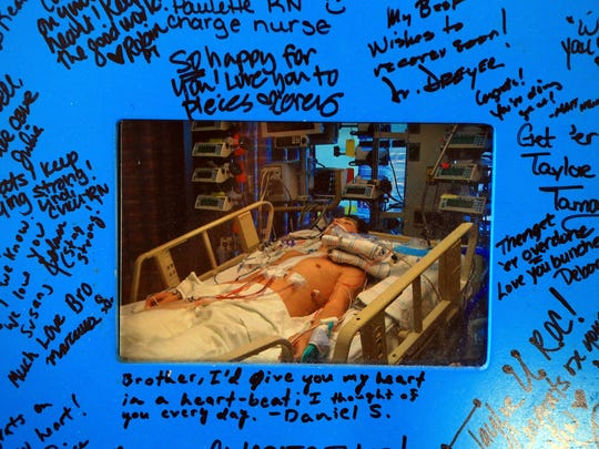 A photo frame of Taylor Berry was signed by friends and nurses when he received his second transplant Friday, June 5, 2015, at his home in Corpus Christi. Berry is a two-time heart transplant recipient receiver and graduated from King High School.