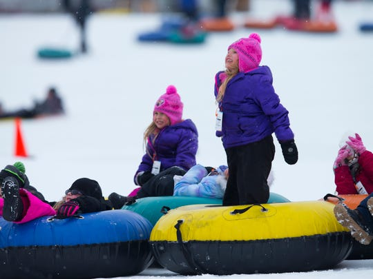Kids play around while snow tubing at Sunburst Winter