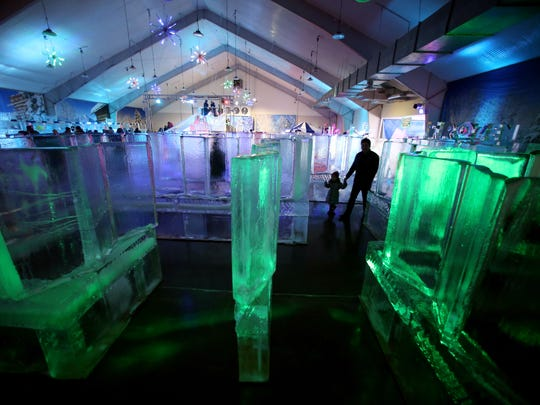 A father and daughter take a walk through the ice maze that first greets you at the Frozen in Ice Carnival at the Skylands Stadium in Frankford is an ice sculpture extravaganza featuring more than 100 tons of ice sculptures, food, and entertainment. February 18, 2017, Frankford Township, NJ.