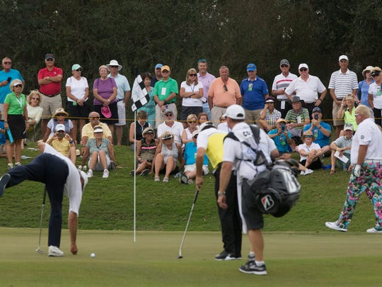 A large crowd gathers around the group of Fred Couples, from left, Billy Andrade, and John Daly on hole No. 10 during the second round of The Chubb Classic at TwinEagles Club Saturday, Feb. 18, 2017 in Naples.