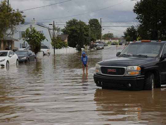 In this file photo, a child walks through waters on East Bolivar Street.