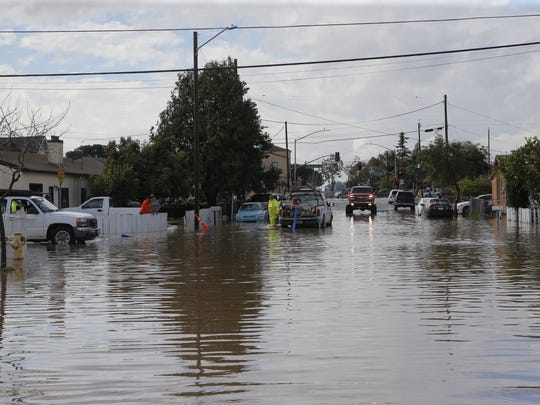 In this file photo, East Bolivar Street in Salinas is flooded after winter rains.