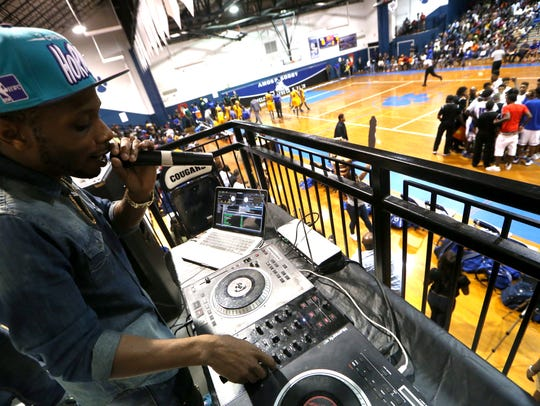DJ Lil Boy plays music during a timeout in Godby's