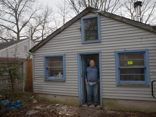 Longtime Toms River resident Larry Hecker at his condemned home.