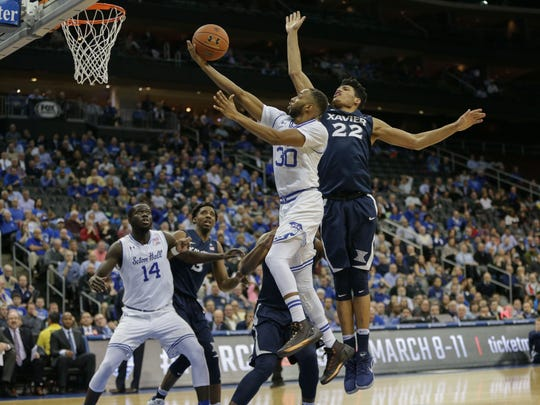 Seton Hall Pirates guard Madison Jones (30) lays up the ball up defended by Xavier Musketeers forward Kaiser Gates (22)