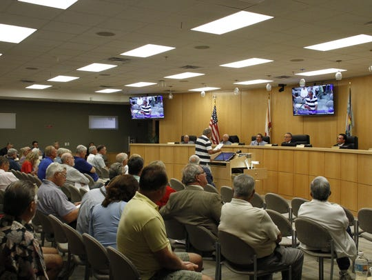 The Marco Island City Council listens to a resident