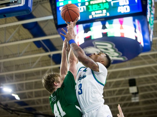Florida Gulf Coast University sophomore, Rayjon Tucker, #3, goes for a layup against Stetson University graduate student, Brian Pegg, #41, during the game against Stetson University on Thursday, February 23, 2017 at Alico Arena in Estero. With an 80-70 win, the Eagles clinched the Atlantic Sun regular-season title and the No. 1 seed in the conference tournament.