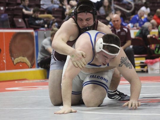 Cameron Tinner, top, of Shippensburg maintains control of Cedar Crest's Ross Fisher during a 285-pound preliminary round bout Thursday in the District 3 Class 3A Tournament. Tinner won by technical fall, 16-1.