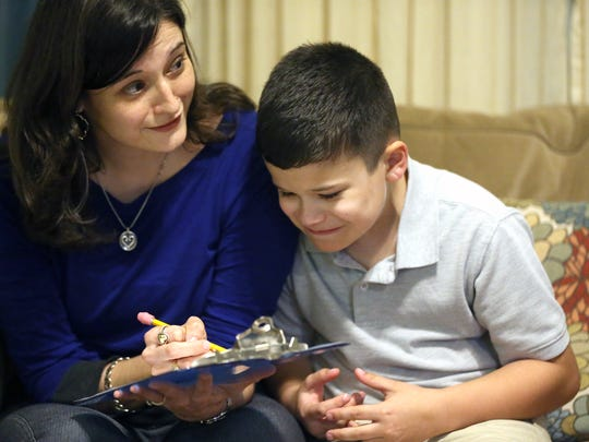 Eli Walker looks at words as his mother Jennifer Alaniz-Walker challenges his brother Lucas during a study session for the 64th Annual South Texas Regional Spelling Bee on Wednesday, Feb. 22, 2017, in Alice.
