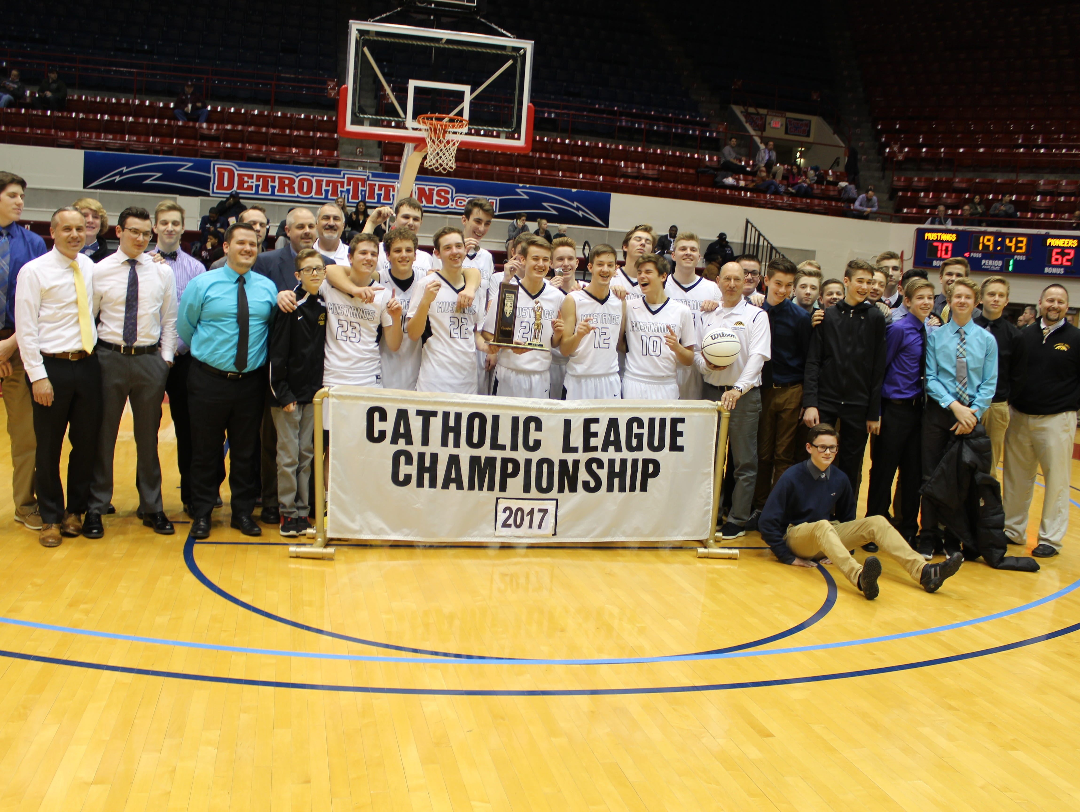 Macomb Lutheran North won Catholic League division titles at the varsity, JV and freshman levels this winter, so all three squads shared in the championship moment Sunday.