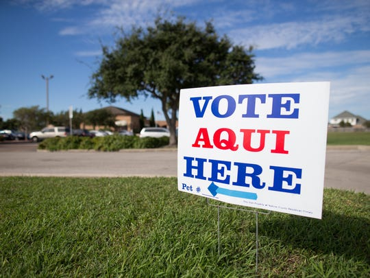 A vote here sign sits outside the Grace Presbyterian Church polling location on election day, Tuesday, Nov. 3, 2015.