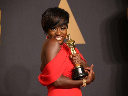 Viola Davis cradles her newly won best supporting actress
