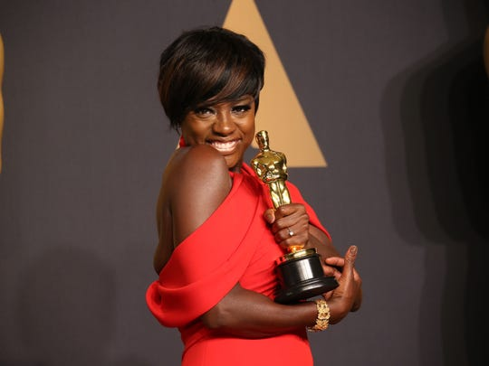 Viola Davis cradles her newly won best supporting actress Oscar.