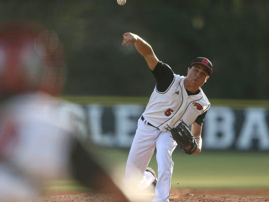 NFC's Matthew Dickey pitches during their game against