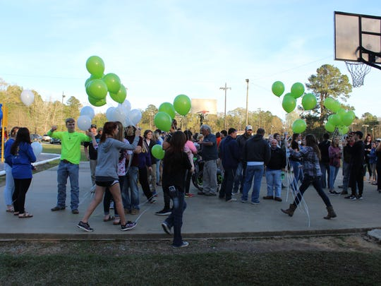 Buckeye High School Class of 2019 students hand out balloons to those attending a student-organized fundraiser Thursday for three people killed after a car crash last week. One of those killed, Haven Coutee, was a Class of 2019 member.