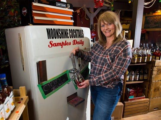Lisa Reissmann, co-owner of The Shinery, pours a sample of cherry moonshine at the company's Neenah location. She and her husband Troy plan to move their Cedarburg location to the building that was formerly occupied by the August Weber Haus restaurant.