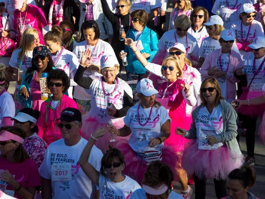 Women cheer and dance as they start the 1 mile walk during the 11th annual Susan G. Komen Race for the Cure at Coconut Point Mall in Estero, Florida on Saturday, March 4, 2017. The event raises significant funds and awareness for the breast cancer movement, celebrates breast cancer survivorship and honors those who have lost their battle with the disease.
