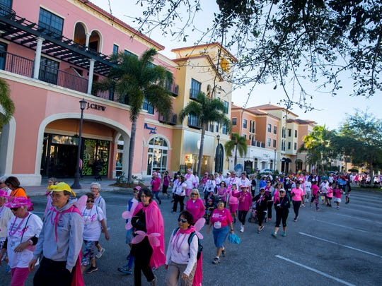 People walk along Fashion Drive during the 11th annual Susan G. Komen Race for the Cure at Coconut Point Mall in Estero, Florida on Saturday, March 4, 2017. The event raises significant funds and awareness for the breast cancer movement, celebrates breast cancer survivorship and honors those who have lost their battle with the disease.