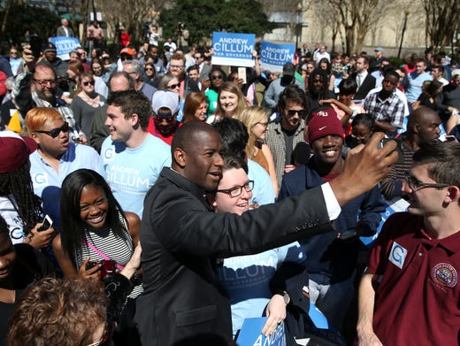Mayor Andrew Gillum takes a selfie with Mark Salter's