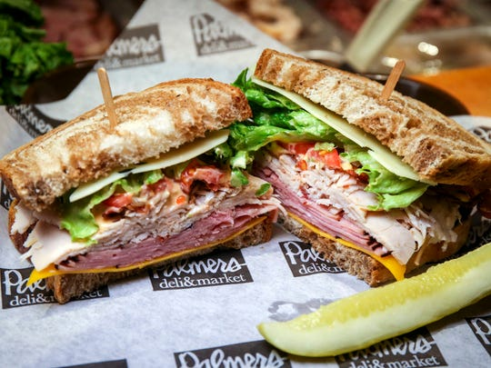 Marshall Field sandwich at Palmer's Deli & Market  Friday March 3, 2017, in the Des Moines Skywalk.  It is made with roasted turkey, ham, bacon, cheddar & Swiss, with lettuce, tomato, and 1000 Island dressing on marble rye - $7.09.