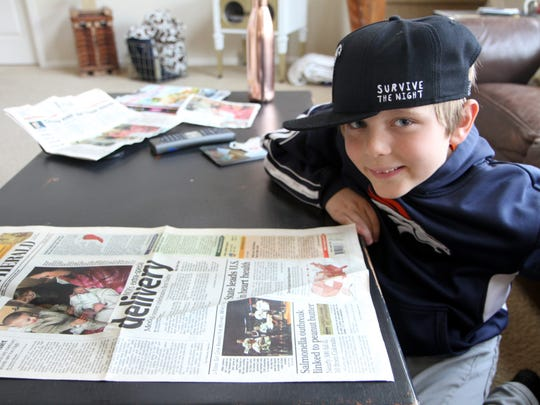 Rohen George looks at the newspaper article from February 2007 announcing him as the first baby to be born at Medical Center of the Rockies. Both George and MCR celebrated their 10th birthday on Feb. 14.