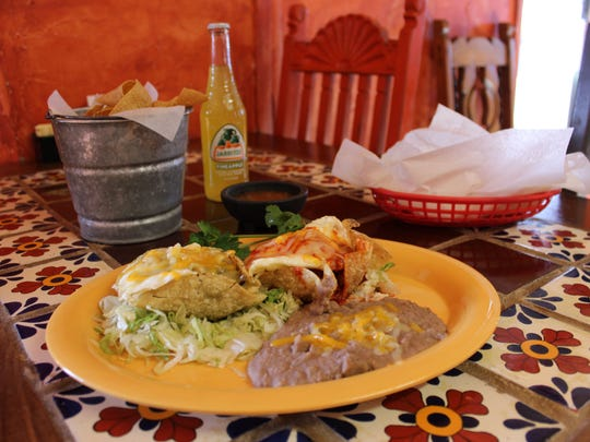 Huevos Compuestas, two corn cups filled with red and green chile, meat, topped with eggs and cheese, served with refried beans, tortillas and chips and salsa at La Nueva Casita Cafe, 195 N. Mesquite St.