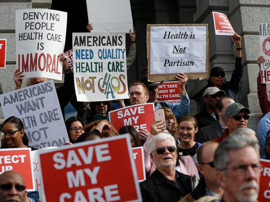 Supporters of the Affordable Care Act gather for a
