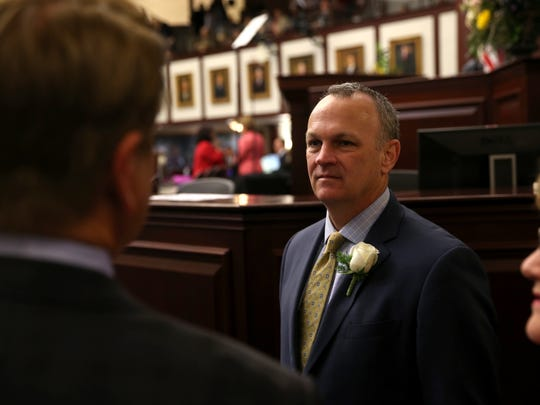 Florida House Speaker Richard Corcoran chats with fellow legislators on the first day of session at the Capitol on Tuesday, March 7, 2017.
