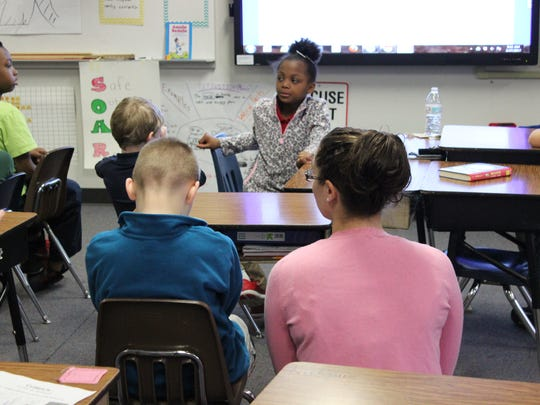 Andrea Spall takes a moment to talk with a student in her class at Fair Lawn Elementary.