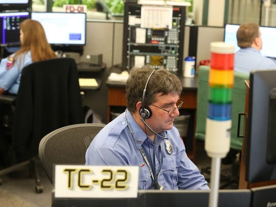 Fire Dispatcher Bill Evans takes a call at his dispatch station at the 911 Call Center located in the Rochester Emergency Communications Office on West Main Street in Rochester on Thursday, March 9, 2017.