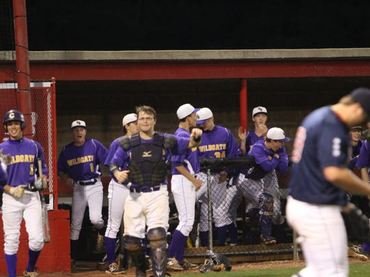 Clarksville High reacts during a game against rival