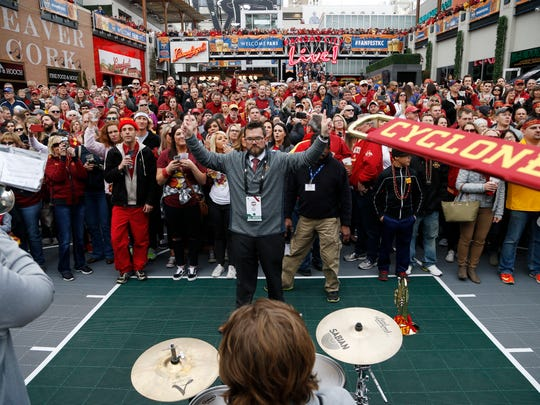 Band director Steven Smyth leads the Cyclone pep band Friday, March 10, 2017 at a pep rally before Iowa State takes on TCU in the semifinals of the Big 12 Men's Basketball Championship in Kansas City.