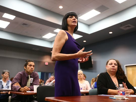 Domestic violence victim Danna Damore speaks during a human trafficking and domestic violence town hall hosted by state Rep. Todd Hunter at Del Mar College's Center for Economic Development on Tuesday, Oct. 4, 2016.