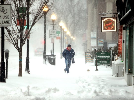 Mike Read of Morristown walks down South Street as a Nor'easter blasts N.J. and the Northeast with heavy snow, high winds. The late-winter storm is expected to drop as much as two feet of snow on Morris County. March 14, 2017, Morristown, NJ