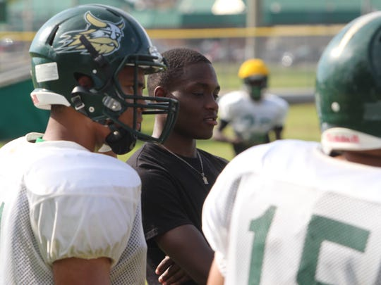 Northwest's Shatar McClay watches with teammates during