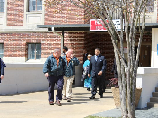 Derrick Stafford (right) exits the Avoyelles Parish