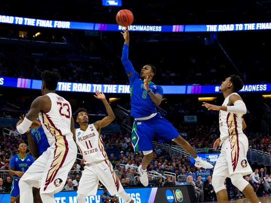Florida Gulf Coast University junior Brandon Goodwin, #0, lays the ball up in the NCAA tournament first round game against Florida State at Amway Center in Orlando on Thursday, March 16, 2017.