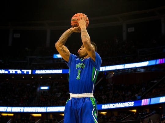 Florida Gulf Coast University sophomore Rayjon Tucker, #3, shoots a three pointer in the NCAA tournament first round game against Florida State at Amway Center in Orlando on Thursday, March 16, 2017. FSU defeated FGCU 86-80.