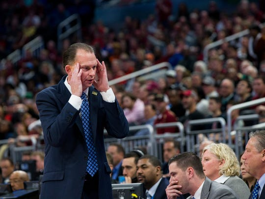Joe Dooley, head coach for Florida Gulf Coast University mens basketball, rubs his forehead in frustration during the NCAA tournament first round game against Florida State at Amway Center in Orlando on Thursday, March 16, 2017. FSU defeated FGCU 86-80.