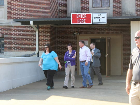 Cathy Mardis (left) and Candace Few (center) leave court on Monday, the first day of testimony in the Derrick Stafford trial. Stafford is accused of fatally shooting Mardis' 6-year-old grandson, Jeremy. Few is the sister of Christopher Few, Jeremy's father.