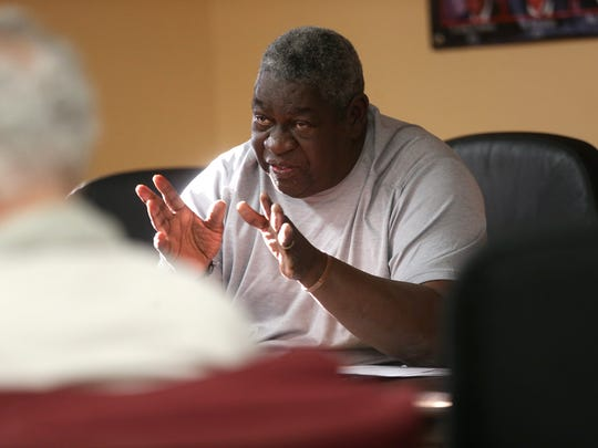 Jim Bellamy, the executive director at Frenchtown Neighborhood Improvement Association, speaks to local residents during a meeting at the Urban League's Ernest Ferrell building on Wednesday, March 15, 2017 to discuss a plan to build student housing in the neighborhood across from Renaissance Center.
