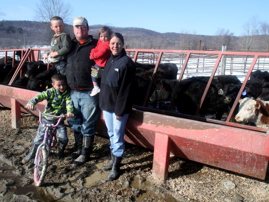 Jason and Heather Kading, with their children Chase,