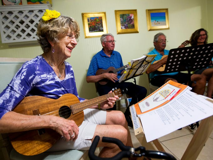 Mary Moran, 78, left, sings and plays the ukulele during