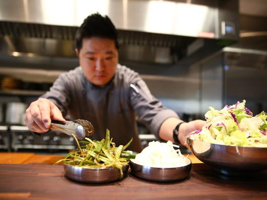 Executive chef Hyunwook Lee prepares Banchan (assortment