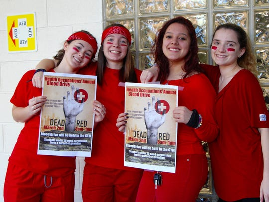 Left to right: SCVTHS Health Occupations students Jenna Molfetta of Bound Brook, Rebeka Quagliato of South Bound Brook, Megan Flores of Bound Brook, and Tiffany Powser of Bridgewater pose during the blood drive.