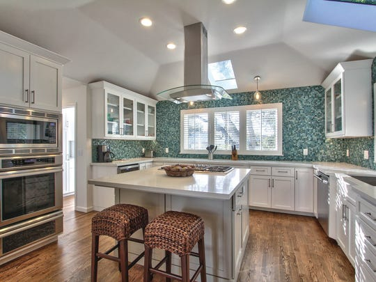 Easy access to the microwave, pullout drawers in the cupboards and motion sensors on the faucet can make this kitchen easier for seniors to live in.